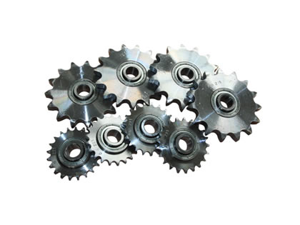 A group of conveyor sprockets.